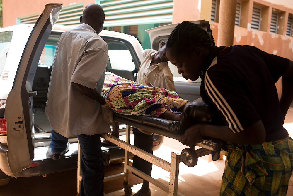 Alima, 21 years old and  7 months pregnant arrives unconscious and having seizures in an ambulance from her local health centre after she started seizures. She arrives with her husband Issouf and older sister Kati.Hospital Yalgado, Ouagadougou, Burkina Faso