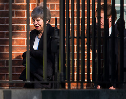© Licensed to London News Pictures. 21/05/2019. London, UK. British Prime Minster THERESA MAY is seen leaving Downing Street via a back door at 6:12pm. On Thursday UK citizens will controversially go to the polls in European elections, three years after a majority voted to leave the EU. Photo credit: Ben Cawthra/LNP