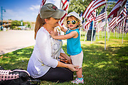 10 SEPTEMBER 2012 - TEMPE, AZ:      JODY TIERNEY and her granddaughter, MIKAYLEE, 19 months old, at the Healing Field in Tempe, AZ, Monday. The Exchange Club of Tempe and the city of Tempe are hosting the 9th Annual Healing Field display. The annual event posts three thousand American flags in the Tempe Beach Park. The flags are 3?X5?  and stand 8? tall. The display is a tribute to those who died in the terrorist attacks of September 11, 2001. Nearly 3,000 people were killed when terrorists affiliated Al-Qaeda crashed commercial airliners into the World Trade Center in New York, the Pentagon in Arlington, VA, and a field in Ohio.   PHOTO BY JACK KURTZ
