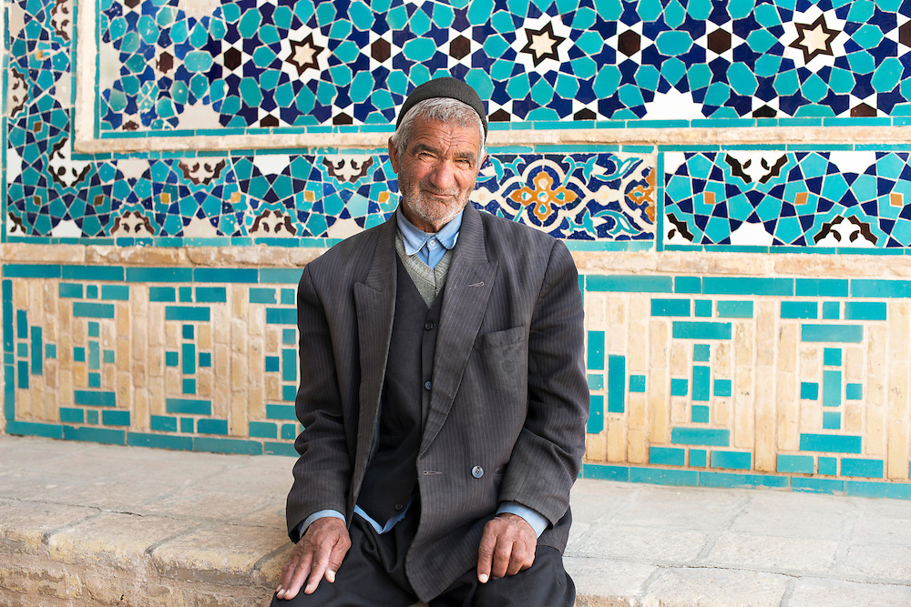 Portrait of a man in front a mosque