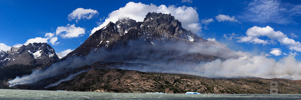 Triple image panoramic of the Torres del Paine National Park Wildfire in Patagonia, Chile on December 28, 2011.