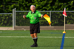 Aubrey Cashman, 79 has been officiating soccer games for more than 25 years. Originally from Belfast, IRE, the seven time grandfather who spends his winters in Florida, runs up and down the field better than most men half his age. He and his team consisting of 70 year old Henry Woo, and the pup in his fifties Frank LaBoone worked the games between Lexington Catholic and Henry Clay, Tuesday, Aug. 13, 2013 at Lexington Catholic Soccer/Football Stadium in Lexington. Photo by Jonathan Palmer