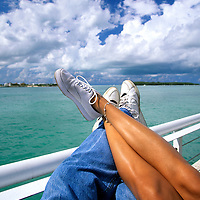 Couple resting on a boat / Cruise. Close-Up of crossed legs.
