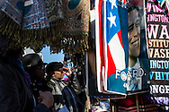People look at Inauguration-themed souvenirs at a street kiosk near the White House on Sunday, January 20, 2013 in Washington, DC.