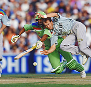 New Zealands Chris Harris races for the ball and collides during the cricket World Cup semi final between the New Zealand Black Caps and Pakistan on 21 March 1992 at Eden Park, Auckland.<br />