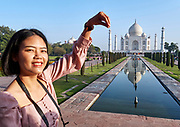 India, Uttar Pradesh. Agra, Taj Mahal. Asian tourists.