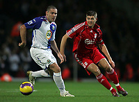 Photo: Paul Thomas/Sportsbeat Images.<br /> Blackburn Rovers v Liverpool. The FA Barclays Premiership. 03/11/2007.<br /> <br /> Steven Gerrard  (Red) passes by Blackburn's David Dunn.