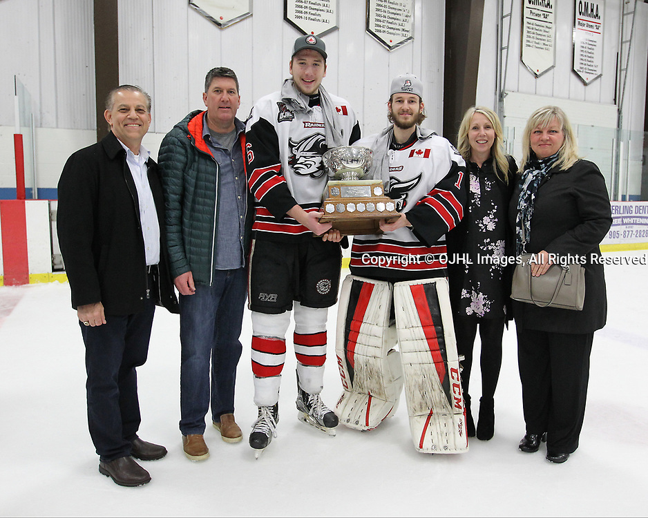 GEORGETOWN, ON  - APR 26,  2017: Ontario Junior Hockey League, Championship Series. Georgetown Raiders vs the Trenton Golden Hawks in Game 7 of the Buckland Cup Final. Players, family members and friends pose with the Buckland Cup.<br /> (Photo by Tim Bates / OJHL Images)