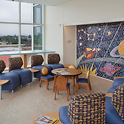 The new Rady Children's Hospital in San Diego California was designed by Anshen & Allen Architects (now Stantec) and Aesthetics, Inc., and completed in September of 2010. The interiors are playful, imaginative and state of the art for medical design. <br /> Interior design details include original art created by San Diego area teenagers, blown up to wall graphic size, original mosaics created by Kim Emerson and landscape design by Royston Hanamoto & Abey
