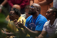 Adrian Taylor (blue) looks on during a memorial service for his son Christian Taylor at Cornerstone Baptist Church in Arlington, Texas on August 12, 2015. (Cooper Neill for The New York Times)