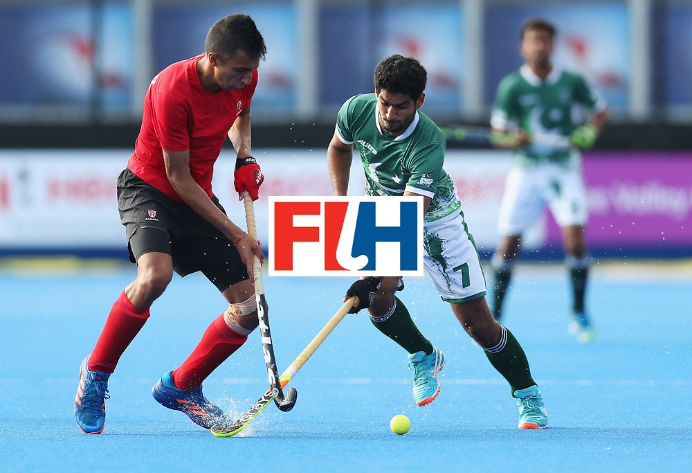 LONDON, ENGLAND - JUNE 16:  Muhammad Arslan Qadir of Pakistan and Balraj Panesar of Canada battle for the ball during the Hero Hockey World League Semi-Final Pool B match between Pakistan and Canada at Lee Valley Hockey and Tennis Centre on June 16, 2017 in London, England.  (Photo by Alex Morton/Getty Images)