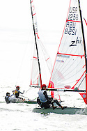 miami, FL, USA, January 4, 2014 - The team of Lucas Pierce and Andrew Person (US 1258) race Max Brill and Zach Malcolm (US 251, at left)  to the windward mark at the 29er Nationals held at Coconut Grove Sailing Club, Jan 1-4, 2013.  Brill and Malcolm finished ahead at 5th place overall.