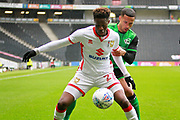 Mk Dons Ike Ugbo (27) shields the ball from Scunthorpe United's Jordan Clarke (2) during the EFL Sky Bet League 1 match between Milton Keynes Dons and Scunthorpe United at stadium:mk, Milton Keynes, England on 28 April 2018. Picture by Nigel Cole.