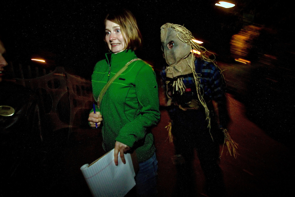 Aleica Warren hurries from one of the masked ghouls at Scarywood in the Silverwood Theme Park during a VIP event Thursday, Sept. 30, 2010.