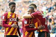 Bradford City midfielder Mark Marshall (7) congratulates Bradford City defender Anthony McMahon (29) on his second goal of the game to make the score 3-0 during the EFL Sky Bet League 1 match between Bradford City and AFC Wimbledon at the Coral Windows Stadium, Bradford, England on 22 April 2017. Photo by Simon Davies.