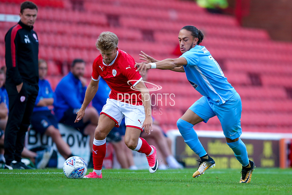 Coventry City midfielder Jodi Jones (11) looks to tackle  during the Pre-Season Friendly match between Barnsley and Coventry City at Oakwell, Barnsley, England on 18 July 2017. Photo by Simon Davies.