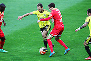 Phoenix' Andrew Durante holds off the challenge of Adelaide United's Craig Goodwin during the Round 22 A-League football match - Wellington Phoenix V Adelaide United at Westpac Stadium, Wellington. Saturday 5th March 2016. Copyright Photo.: Grant Down / www.photosport.nz