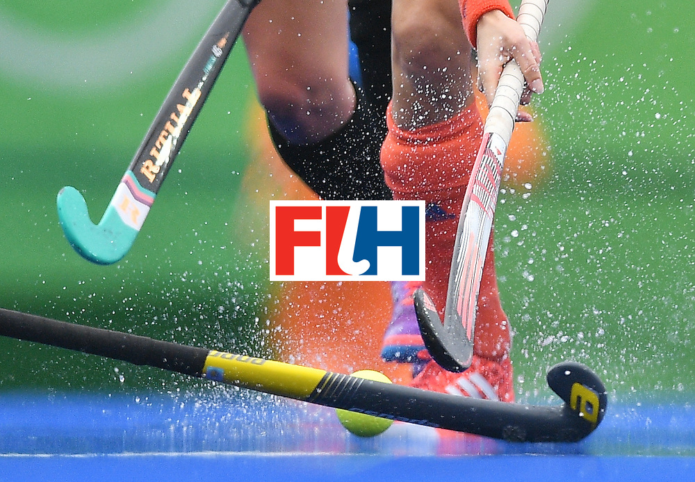 Netherlands' Naomi As van (R) is tackled by New Zealand's Petrea Webster (L) during the womens's field hockey New Zealand vs Netherlands match of the Rio 2016 Olympics Games at the Olympic Hockey Centre in Rio de Janeiro on August, 12 2016. / AFP / Carl DE SOUZA        (Photo credit should read CARL DE SOUZA/AFP/Getty Images)
