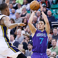 27 January 2016: Charlotte Hornets guard Jeremy Lin (7) takes a jump shot over Utah Jazz guard Rodney Hood (5) during the Utah Jazz 102-73 victory over the Charlotte Hornets, at the Vivint Smart Home Arena, Salt Lake City, Utah, USA.