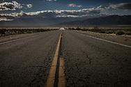 Sand blows across an empty desert highway near Coyote Mountain in the Anza-Borrego Desert.  California