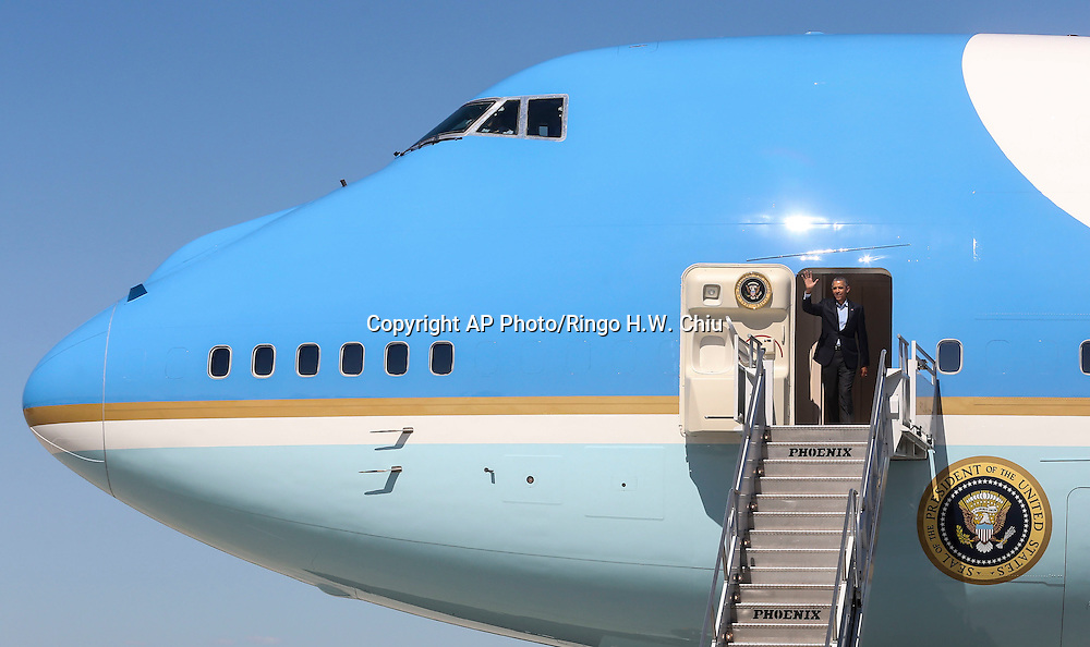 President Barack Obama waves as he disembarks from Air Force One upon his arrival at Los Angeles International Airport in Los Angeles on Saturday, Oct. 10, 2015.  (AP Photo/Ringo H.W. Chiu)