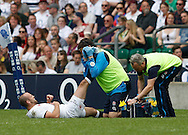 Charlie Sharples of England receives treatment before being substituted during the International Test Match match at Twickenham Stadium, Twickenham<br /> Picture by Andrew Tobin/Focus Images Ltd +44 7710 761829<br /> 01/06/2014