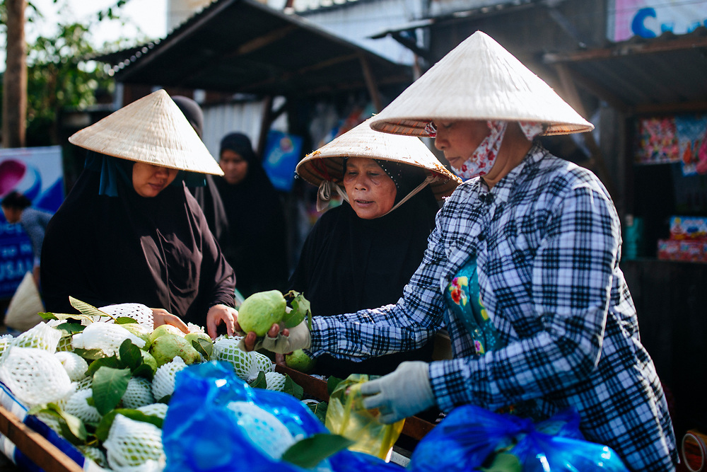 Muslim-Vietnamese women near Mubarak Mosque in Chau Doc in the Mekong Delta.