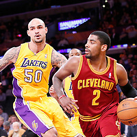 14 January 2014: Cleveland Cavaliers point guard Kyrie Irving (2) drives past Los Angeles Lakers center Robert Sacre (50) during the Cleveland Cavaliers 120-118 victory over the Los Angeles Lakers at the Staples Center, Los Angeles, California, USA.