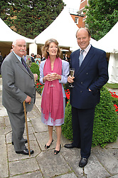 Left to right, SIR JAMES CAYZER, ANABEL ELWORTHY and MARK ETHERINGTON at a reception for the Friends of The Castle of Mey held at The Goring Hotel, London on 20th May 2008.<br /><br />NON EXCLUSIVE - WORLD RIGHTS