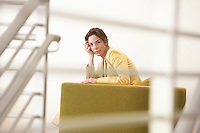 Businesswoman waiting on sofa in office portrait