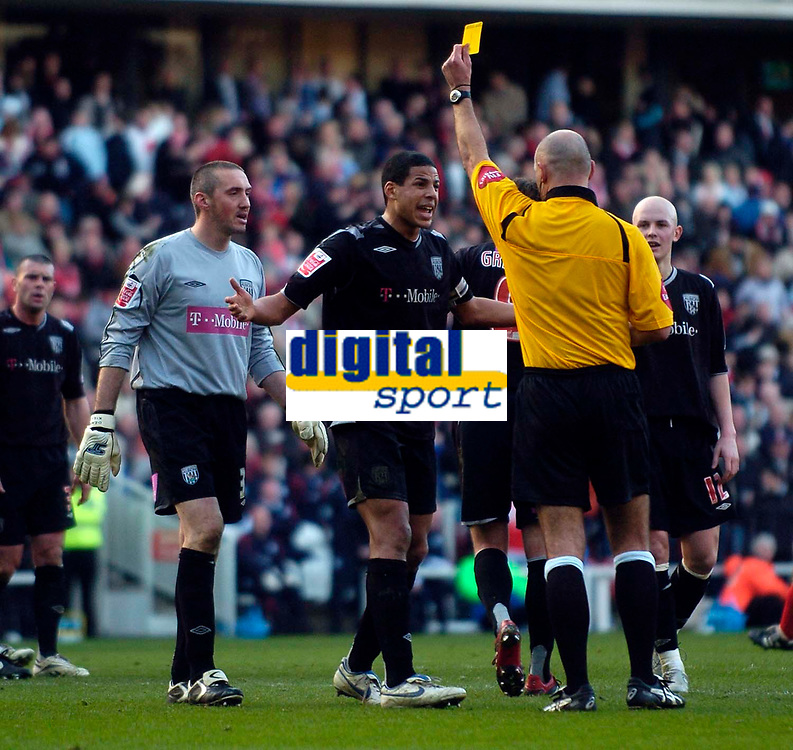 Photo: Jed Wee/Sportsbeat Images.<br /> Middlesbrough v West Bromwich Albion. The FA Cup. 17/02/2007.<br /> <br /> West Brom's Curtis Davies (C) protests as referee Howard Webb shows him the yellow card.