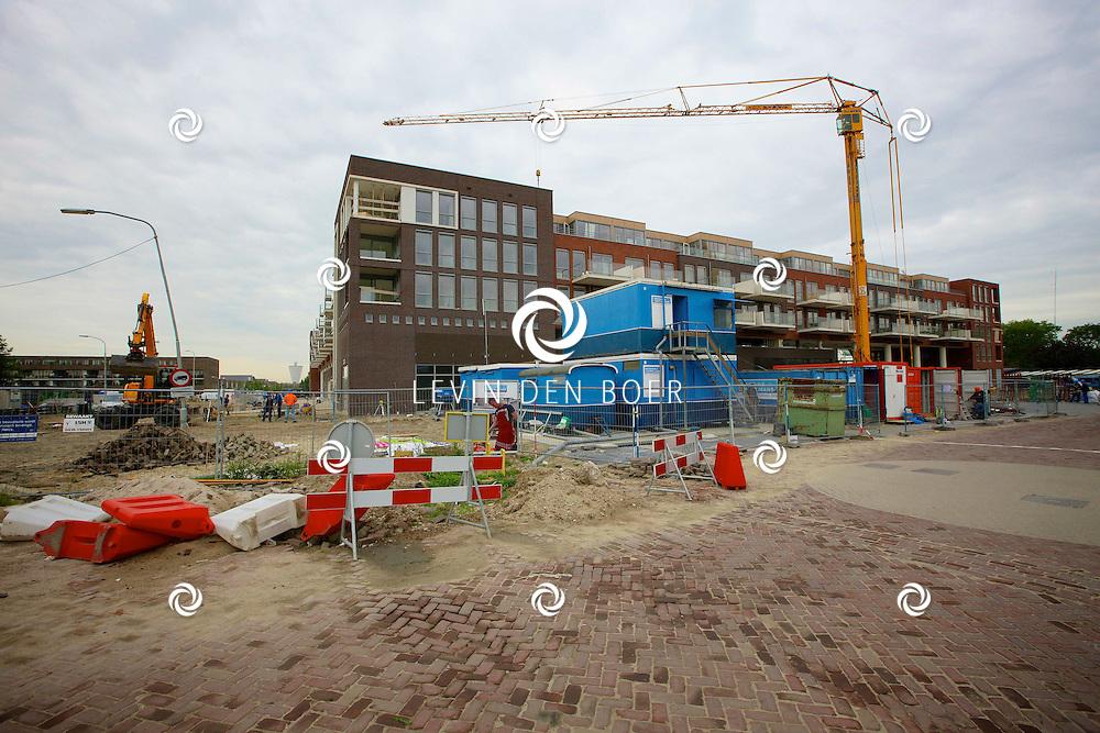 ZALTBOMMEL - Het nieuwe winkelcentrum met woningen genaamd Portage is bijna klaar voor oplevering. FOTO LEVIN DEN BOER - PERSFOTO.NU