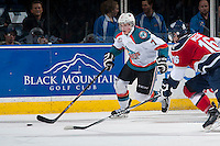 KELOWNA, CANADA - MARCH 27:  Lucas Johansen #7 of Kelowna Rockets  moves the puck behind the net against the Tri-City Americans on March 27, 2015 at Prospera Place in Kelowna, British Columbia, Canada.  (Photo by Marissa Baecker/Shoot the Breeze)  *** Local Caption *** Lucas Johansen;