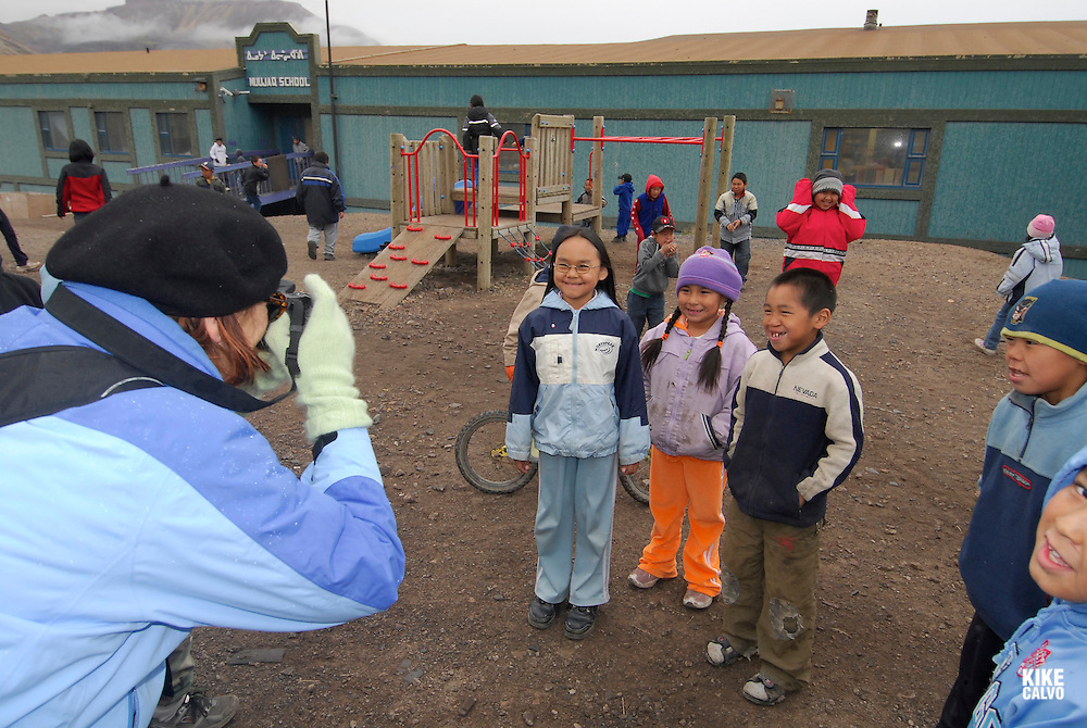 Children playing on a school break. School. Coastal Inuit community of Arctic Bay. Lancaster Sound. HIgh Arctic. Baffin Island. <br /> (people, kid,.