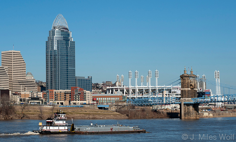 A barge passing along the Cincinnati Skyline