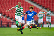 Nathan Young-Coombes (#9) of Rangers FC tackles Christopher McQueen (#5) of Celtic FC during the Scottish FA Youth Cup Final match between Celtic and Rangers at Hampden Park, Glasgow, United Kingdom on 25 April 2019.