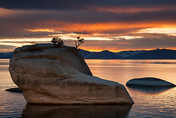 """Bonsai Rock Sunset 4"" - Photograph of a orange and yellow sunset at Bonsai Rock on Lake Tahoe."