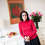 March 4, 2014 - New York, NY : <br /> Sabiha Al Khemir, a writer and curator of Islamic Art, poses for a portrait in her apartment in Manhattan on Tuesday morning, March 4. A painting of a pomegranate, painted for her by an Iraqi artist, hangs on the wall behind her. <br /> CREDIT: Karsten Moran for The New York Times