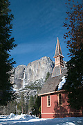 The small chapel in Yosemite National Park during winter,with Yosemite Falls in the background.