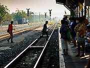 14 JANUARY 2016 - CHACHOENGSAO, CHACHOENGSAO, THAILAND: People cross the train tracks in Chachoengsao Train station east of Bangkok.          PHOTO BY JACK KURTZ