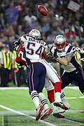 The loose ball flies in the air as New England Patriots middle linebacker Dont'a Hightower (54) strip sacks Atlanta Falcons quarterback Matt Ryan (2) while Ryan attempts a pass for a loss of 11 yards and a fumble recovered by the Patriots at the Falcons 25 yard line as the Patriots begin their comeback win during the Super Bowl LI football game against the Atlanta Falcons on Sunday, Feb. 5, 2017 in Houston. The Patriots won the game 34-28 in overtime. (©Paul Anthony Spinelli)