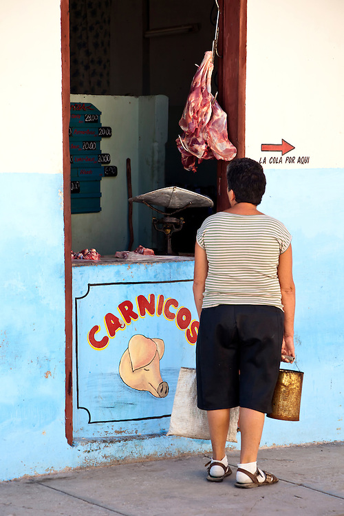 Woman at butcher shop in Holguin, Cuba.