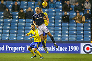 Millwall forward Steve Morison (20) heads clear during the EFL Sky Bet Championship match between Millwall and Birmingham City at The Den, London, England on 28 November 2018.