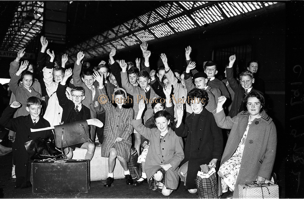 11/09/1962<br /> 09/11/1962<br /> 11 September 1962<br /> Gael Linn Scholarship winners leave for the Gaeltacht.<br /> Over 30 scholarship winners left Westland Row Station (Pearse Station), Dublin to spend three months in the Gaeltacht. Image shows some of the children waving goodbye to their relatives before boarding the train.