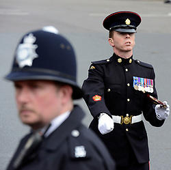© Licensed to London News Pictures. 09/05/2012. Westminster, UK A policeman and a soldier at the event. The procession carrying Queen Elizabeth II on its way to the Palace of Westminster today 9th May 2012. It is the first Queen's Speech, the grandest event on the parliamentary calendar, since shortly after the coalition Government was formed. The statement usually takes place each autumn. Photo credit : Stephen Simpson/LNP