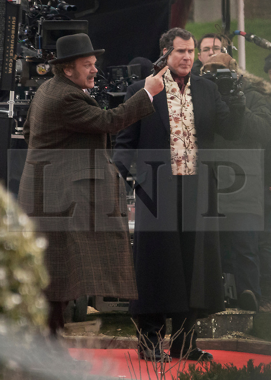 © Licensed to London News Pictures. 09/02/2017. London, UK. Actors Will Ferrell and John C. Reilly are seen with pistols as they film a scene from the new Sherlock Holmes movie 'Holmes and Watson' at Hampton Court. Photo credit: Peter Macdiarmid/LNP