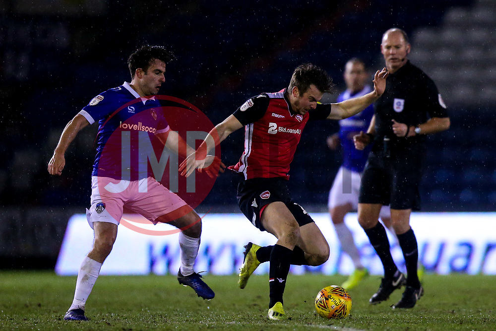 Rhys Oates of Morecambe takes on Jose Baxter of Oldham Athletic  - Mandatory by-line: Robbie Stephenson/JMP - 19/02/2019 - FOOTBALL - Boundary Park - Oldham, England - Oldham Athletic v Morecambe - Sky Bet League Two