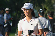 Fifteen year old Michelle Wie smiles after a tee shot during a practice round prior to The 2005 Sony Open In Hawaii. The event was held at The Waialae Country Club in Honolulu.