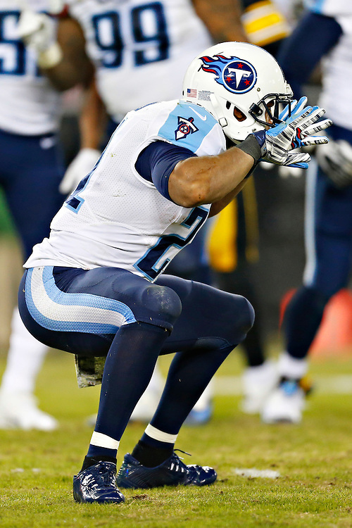 NASHVILLE, TN - NOVEMBER 17:  George Wilson #21 of the Tennessee Titans celebrates after a tackle during the second quarter of a game against the Pittsburgh Steelers at LP Field on November 17, 2014 in Nashville, Tennessee.  The Steelers defeated the Titans 27-24.  (Photo by Wesley Hitt/Getty Images) *** Local Caption *** George Wilson