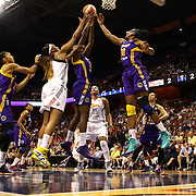 Nneka Ogwumike, Los Angeles Sparks, (right), combines to rebound with team mate Jantel Lavender, challenged by Kelsey Bone, Connecticut Sun as Candace Parker, Los Angeles Sparks, (left), looks on during the Connecticut Sun Vs Los Angeles Sparks WNBA regular season game at Mohegan Sun Arena, Uncasville, Connecticut, USA. 3rd July 2014. Photo Tim Clayton